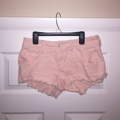 Light Pink Dollhouse Shorts These shorts are in perfect condition! NWOT. Purchased a couple years ago and never ended up wearing them. They are a Size 7. Light pink and frayed at the bottom. Super stylish and can be paired with many different tops! Dollhouse Shorts