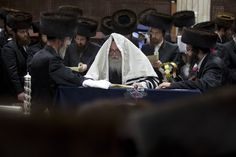 Ultra Orthodox Jews read the Esther scrolls at a synagogue in the Israeli town of Bnei Brak near Tel Aviv on March 7 during celebrations of the Purim holiday. The carnival-like Purim holiday is celebrated from the evening of March 7 with parades and costume parties to commemorate a plot to exterminate them in the ancient Persian empire 2,500 years ago, as recorded in the Book of Esther. (Mehahem KahanaAFP/Getty Images) #