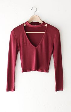 - Description Details: Soft knit long sleeve crop top in red with deep v-neck & choker mock neckline. Form fitting, tend to run on the smaller side & are more fitted. Measurements: (Size Guide) S: 28""