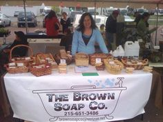 Melissa selling soap at the green fair