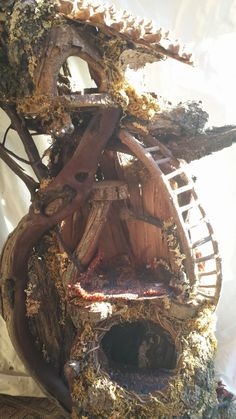 one of a kind houses made from natures materials for all the wee woodland folk
