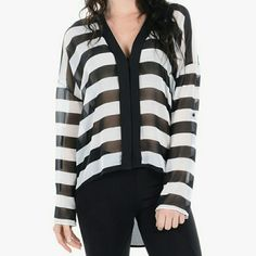 Over Stripe Sheer Hi Low Blouse The cover photo is not the exact same blouse but just to give you an idea on how it would look when worn. This cute black/white stripes blouse can be worn in the spring because of its sheer fabric; nice and loose fit. Also great for layering in the winter with some tights or skinny jeans and boots to complete the looks. This is a v-neck blouse (front & back), button-tab roll up sleeves that can be worn long or short. Worn only once, still in good condition…