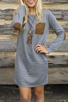The dress is featuring paneled, long sleeve and round neckline.