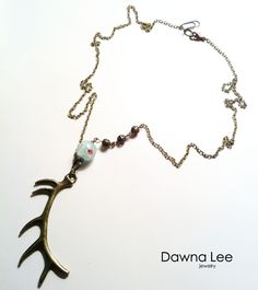 I love the bead on this necklace...and of course the antlers!