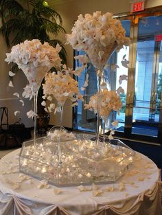 White rose inspired place card table decoration. #white #roses #orchids #yannidesignstudio