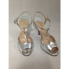 """Mirror-shiny patent leather, with a t-strap and adjustable ankle buckle these Christian Louboutin """"Ernesta"""" sandals are made for dancing. Si..."""