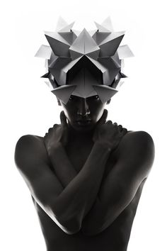 Origami headgear folded to resemble mythological creatures.