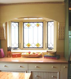 cottage style kitchen cabinets - I love those windows actually.