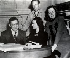 David O. Selznick, Vivien Leigh, Leslie Howard, and Olivia de Havilland going over contracts to sign for Gone With the Wind