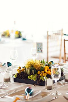 Modern wedding centerpieces with Mexican Tarot cards as table name. Photography by Elizabeth Lloyd Photography www.elfoto.org
