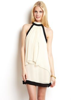 This Esley halter shift dress is to die for. The unique construction has both elegant and mod appeal.
