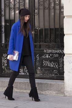 blue coat over black clothes