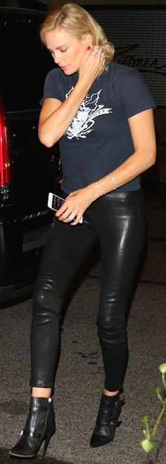 Who made Charlize Theron's black leather pants, ankle boots, and jewelry?