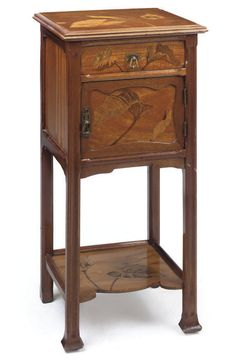 EMILE GALLÉ | A MAHOGANY AND MARQUETRY SIDE CABINET