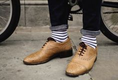 Striped men socks in brown leather shoes. Beautiful.