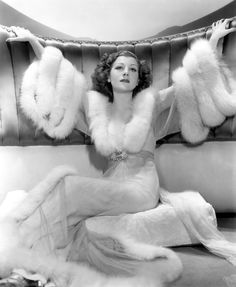 a fur trimmed dressing gown for lounging in one's boudoir ...