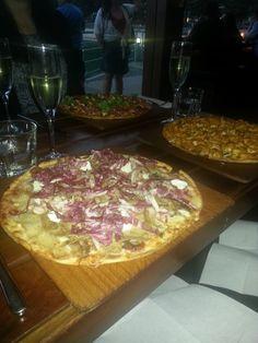 Pork Pizza ‐ slow roasted pork belly with sweet & sour onions, radicchio & buffalo milk mozzarella at Hugo's, Manly, NSW.