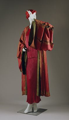 ~Mariano Fortuny dressing gown, circa 1930~ With slashed sleeves extending far beyond the length of the arm like a mandarin's robes, Fortuny's wraps, capes, and gowns are in the realm of high fantasy. Primary sign or reference—or what seems to be specific location—is established by the stenciling that suggests the kufic and corded embroideries of North African djellabahs.