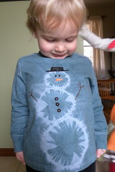 Snowman tie-dye kids shirt. Start with a white shirt, gather your circles and dye the shirt the colour you want.