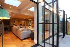 The substantial extension on this detached house features bespoke art deco style steel French doors which adds to the striking structural elements of the room. Glass Extension, Bungalow Renovation, Art Deco Home, Villa, House Extensions, Open Plan Living, Patio Doors, Small Rooms, Detached House
