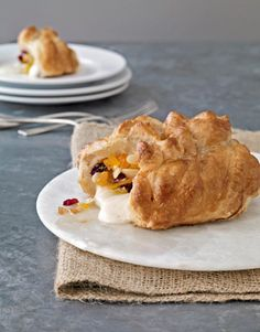 The hidden surprise in this baked treat? Sweet fruit, honey, and Brie.  Recipe: Cranberry-Apricot Baked Brie with Honey   - CountryLiving.com