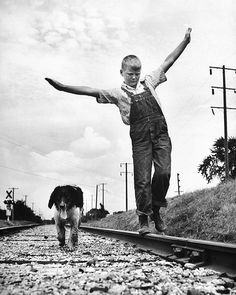 """The September 3, 1945 SPEAKING OF PICTURES featured a quintessential summer photo essay about """"the pleasures of a boy and his dog."""" in Oskaloosa, Iowa. - The original caption for this image: """"Tired and thoroughly dirty from a hard day's play, Dunk..."""