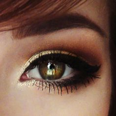 Add a pop of gold eyeshadow to make your eyes stand out.