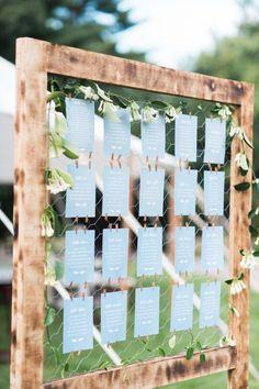Rustic escort card display: http://www.stylemepretty.com/2017/02/06/anything-but-boring-backyard-wedding-in-massachusetts/ Photography: Jenny Moloney - http://jennymoloney.com/