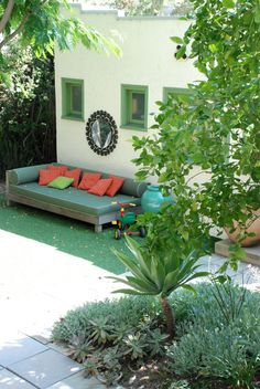 Whether you're inside or outside #Emerald is the perfect color to create a serene scene.  Check out this outdoor space filled with the #ColoroftheYear.
