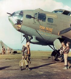 "A B-17 nicknamed ""Tom Paine"" sits ready to begin a mission as its crew loads up for the coming fight. The bomber's base was near the birthplace of American patriot Thomas Paine in Thetford, England."