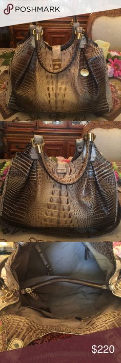 Authentic Brahmin Elissa purse This is a very elegant slightly used purse.  almost  in mint condition. I've posted it several times because someone was trying to scam me and I didn't realize until I was made aware of it by another posher but it is  available. If you have any questions please contact me. Bags Shoulder Bags