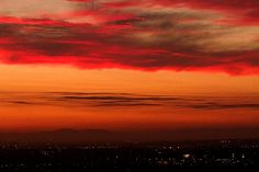 Gorgeous red and gold sunset over LA by Denise Dube. The smog may cause problems but it also makes for a spectacular night sky!