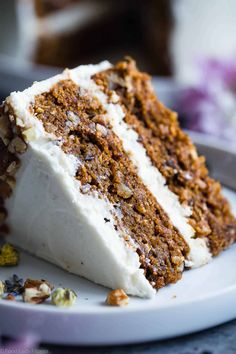 The BEST Gluten Free Vegan Carrot Cake - This one bowl, healthy carrot cake is SO moist and tender, you'll never know it's plant based, made without eggs and is gluten/grain/dairy/refined sugar free! Perfect for Easter!