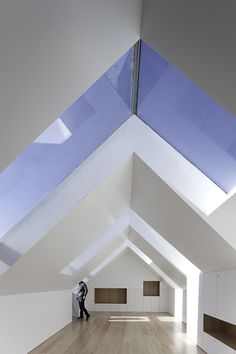 light windows with roof angle - interesting space. Has a mood to it with colors and light.