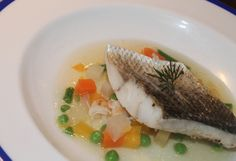 Wine Tasting Dinner with a Grazing Menu. Sea Bass with crab broth and macedoine of vegetables.
