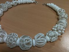 Lampworked glass beads, inspired by the beautiful corals on Aruba. By Marian, Terrafuse.
