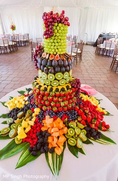 A fruit stand with a selection of fruits for your health conscious guests! How c… A fruit stand with a selection of fruits for your health conscious guests! How colourful & yummy looking is this arrangement 😋! Photo by MP Singh photography Fruit Centerpieces, Fruit Decorations, Edible Arrangements, Fruit Tables, Fruit Buffet, Fruit Trays, Fruit Display Wedding, Fruit Wedding Cake, Fruit Presentation