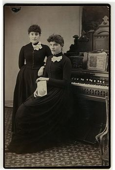 https://flic.kr/p/7h8YKL | young ladies holding photograph of Daniel F. Beatty, reed organ manufacturer