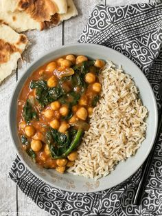 These super fast Curried Chickpeas with spinach are packed with flavor and nutrients, vegan, gluten-free, and filling! Plus they freeze great! BudgetBytes.com