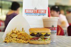Half pound burger, crinkle cut fries, and a chocolate milkshake.
