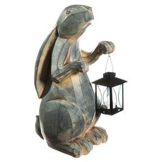 Carved rabbit-shaped garden statue with a lantern.  Product: Garden statue and lanternConstruction Material: Pol...