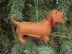This three dimensional little dachshund ornament will be a sweet and whimsical addition to your Christmas tree, a special keepsake ornament for a dog lover in your life, or to commemorate a cherished pet. Made from merino wool felt and carefully hand stitched, this little dog is