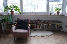 Low slung bookcases are a neat storage idea for a bay window