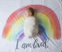 Inspired by parenthood, the struggles and joys, we wanted to create a beautiful design to honor Rainbow Babies.   Our Rainbow Blanket serves as a beautiful reminder of your endless and unwavering love for your child(ren). A stunning backdrop for baby, a forever keepsake or the perfect, one of a kind gift.
