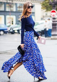 Patricia Manfield wears a Stella McCartney printed skirt, sweater, cat-eye sunglasses, and strappy heels