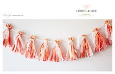 Fabric garland in turquoise,coral, and silver for the wedding?