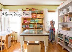 A sunny sewing room and folding fabrics to size. Love, love, love this room!