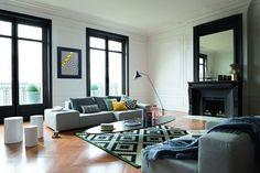 Restez classe et raffiné avec un salon peint en noir et blanc