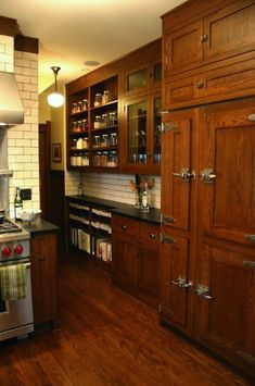 Oak cabinets stained darker, without going all the way to espresso.Note the fridge!