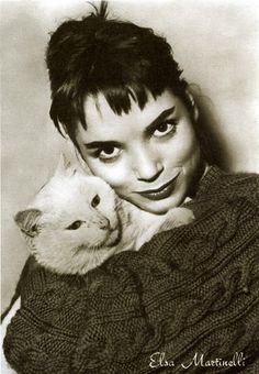 Elsa Martinelli and white cat in her pullover